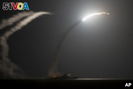 U.S.and Arab Allies Bomb Militant Targets in Syria