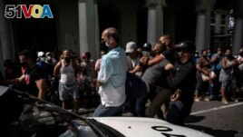 Police detain an anti-government demonstrator during a protest in Havana, Cuba, Sunday July 11, 2021. (AP Photo/Ramon Espinosa)