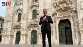 Italian opera singer Andrea Bocelli sings in an empty Duomo Square in Milan, Italy, on Easter Sunday, April 12, 2020. (Reuters File Photo/Alex Fraser)
