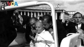 FILE - Pope John Paul II lies bleeding in his open car moments after he was shot by Turkish gunman Mehmet Ali Agca in 1981.