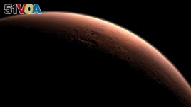 This computer-generated images depicts part of Mars at the boundary between darkness and daylight, with an area including Gale Crater, beginning to catch morning light. Northward is to the left. Gale is the crater with a mound inside it near the center of the image. NASA selected Gale Crater as the landing site for Curiosity. (NASA)