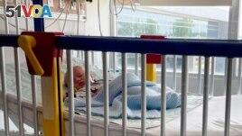 In this June 2021 photo provided by LaRanda St. John, her 6-week-old son, Beau, lies in a hospital bed at the Sarah Bush Lincoln Health Center in Matoon, Illinois. (LaRanda St. John via AP)
