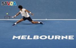 South Korea's Chung Hyeon makes a backhand return to Serbia's Novak Djokovic