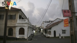 In this Friday, May 10, 2019, photo, a street that is usually crowded with tourists is seen empty in Galle, Sri Lanka. (AP Photo/Eranga Jayawardena)