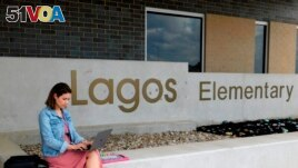 First-year teacher Cindy Hipps sits outside of Lagos Elementary School, at Manor Independent School District campus east of Austin, Texas