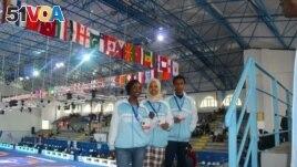 Munirah Warsame, left, is seen in an undated photo at a teakwondo competition. (Courtesy - Somalia Teakwondo Team)