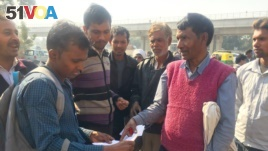 Ishwari Lal, who works at a construction site, has been told by his building contractor that he will pay his wages in a bank account due to currency shortages.