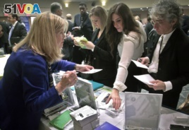 Patricia Mazza, left, meets job seekers, including recent college grads Ashley Deyo, 22, second from left, and Chyna Dama, 23, second from right, during a 2012 National Career Fairs' job search event in New York.