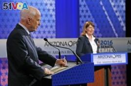 Sen. John McCain, left, debates Rep. Ann Kirkpatrick during recent Senate debate.