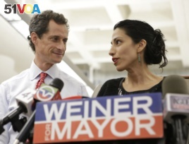 Anthony Weiner with wife, Huma Abedin, in 2013. Abedin recently announced that the couple is separating.
