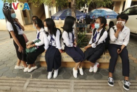 Students wearing face-masks, wait for their morning school class at Santhormok high school, in Phnom Penh, Cambodia, Monday, Nov. 2, 2020. (AP Photo/Heng Sinith)
