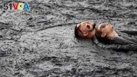 People take a mud bath during the