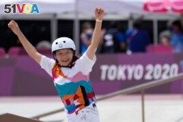 Momiji Nishiya of Japan reacts after winning the women's street skateboarding finals at the 2020 Summer Olympics, Monday, July 26, 2021, in Tokyo, Japan. (AP Photo/Ben Curtis)