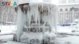 This photo is of a frozen fountain in New York City's Bryant Park during a winter storm on February 1, 2021. (Photo by TIMOTHY A. CLARY / AFP)