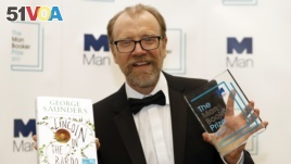 Author George Saunders of the United States holds his book