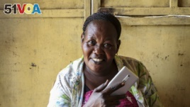 Rhoda Fresa doesn't want to sign up for South Sudan's own mobile money service because everyone she knows has already fled the country to Uganda.