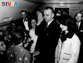 Lyndon Johnson takes the oath of office