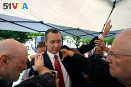 FILE - In this June 7, 2021 file photo, Tony Spell, pastor of the Life Tabernacle Church of Central City, La., prays with supporters outside the Fifth Circuit Court of Appeals in New Orleans.