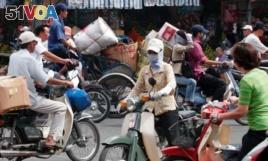 FILE- Motorbikes on the street of Ho Chi Minh City. (Hai Do)