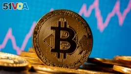 FILE - A representation of virtual currency Bitcoin is seen in front of a stock graph in this illustration taken November 19, 2020. (REUTERS/Dado Ruvic/Illustration/File Photo)