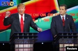 Republican U.S. presidential candidate businessman Donald Trump (L) speaks as Senator Ted Cruz (R) watches during the Republican presidential debate in Las Vegas, Nevada, Dec. 15, 2015.