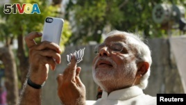 FILE - Hindu nationalist Narendra Modi, the prime ministerial candidate for India's main opposition Bharatiya Janata Party (BJP), takes a