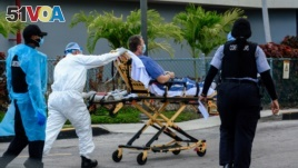 Emergency Medical Technicians (EMT) arrive with a patient at North Shore Medical Center where the coronavirus disease (COVID-19) patients are treated, in Miami, Florida, July 14, 2020.