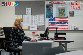 Sue Ziel, a sixth grade social studies teacher at Romeo Middle School, works in her classroom in Romeo, Mich., Tuesday, April 27, 2021. (AP Photo/Paul Sancya)