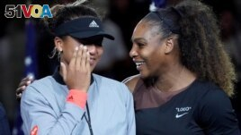 FILE - Naomi Osaka of Japan (left) cries as Serena Williams of the USA comforts her after the crowd booed during the trophy ceremony following the women's final on day thirteen of the 2018 U.S. Open tennis tournament. (Bob Deutsch/USAToday Sports/Reuters)