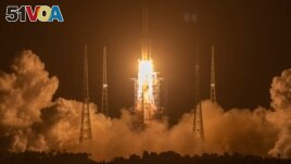 In this Nov. 24, 2020, file photo, a Long March-5 rocket carrying the Chang'e 5 lunar mission lifts off at the Wenchang Space Launch Center in Wenchang in southern China's Hainan Province. (AP Photo/Mark Schiefelbein, File)