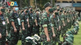 Army soldiers line up during a ceremony to send off military doctors to Ho Chi Minh City to help with treating COVID-19 patients in Hanoi, Vietnam, Monday, Aug. 23, 2021. (Bui Cuong Quyet/VNA via AP)