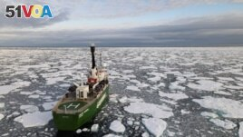 FILE - Greenpeace's Arctic Sunrise ship navigates through floating ice in the Arctic Ocean, Sept. 15, 2020.