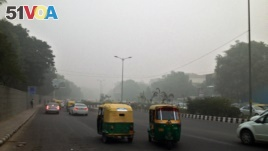 Even during the day visibility was poor on the streets of New Delhi, India, due to high pollution levels, Nov. 6, 2016.