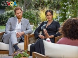 This undated image released March 7, 2021 courtesy of Harpo Productions shows Britain's Prince Harry (L) and his wife Meghan (C), Duchess of Sussex, in a conversation with US television host Oprah Winfrey. - Britain's royal family on March 7, 2021...
