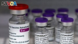 Vials of the AstraZeneca and Pfizer-BioNTech Comirnaty coronavirus disease (COVID-19) vaccines are pictured in a General practitioners practice in Berlin, Germany, April 10, 2021.
