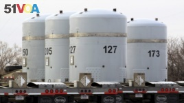 In this March 6, 2014, file photo, empty nuclear waste shipping containers sit in front of the Waste Isolation Pilot Plant near Carlsbad, N.M. (AP Photo/Susan Montoya Bryan, File)