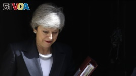Britain's Prime Minister Theresa May leaves 10 Downing Street to attend the weekly session of Prime Ministers Questions in Parliament in London, May 22, 2019. (AP Photo/Kirsty Wigglesworth)
