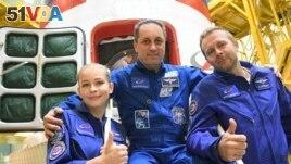 Crew members, cosmonaut Anton Shkaplerov, actress Yulia Peresild and film director Klim Shipenko.
