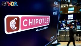FILE - The logo for Chipotle appears above a trading post on the floor of the New York Stock Exchange.