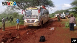 Kenyan security forces gather around the scene on an attack on a bus about 50 kilometers outside the town of Mandera on Nov. 22, 2014. There was another bus attack on Monday. (AP)