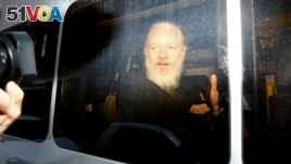 WikiLeaks founder Julian Assange is seen in a police van, after he was arrested by British police, in London, Britain April 11, 2019. (REUTERS/Henry Nicholls)