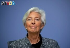 FILE -- In this Thursday, March 12, 2020 file photo the President of European Central Bank Christine Lagarde looks up prior to a press conference following a meeting of the ECB governing council in Frankfurt, Germany.