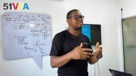 Samuel Anyaele teaches coding using a phone in Lagos, Nigeria, May 19, 2021. (REUTERS/Seun Sanni)