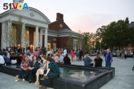 Parents and new students enjoy an event outside Hoover Dining Hall welcoming them to DePauw University.