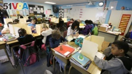 In this April 18, 2014 file photo, students are shown in a fourth-grade classroom at Olympic View Elementary School in Lacey, Washington. (AP Photo/Ted S. Warren)