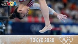 Sunisa Lee, of the United States, starts off on the right foot to win the all-around final at the 2020 Summer Olympics on July 29, 2021, in Tokyo. (AP Photo/Natacha Pisarenko)