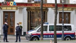 Police officers stand in front of Hotel Imperial where a delegation from Iran is staying in Vienna, Austria, Tuesday, April 6, 2021. (AP Photo/Florian Schroetter)