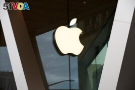 FILE - An Apple logo adorns the facade of a downtown Brooklyn Apple store in New York, March 14, 2020. Apple is heading into a trial that threatens to upend its app store that earns the tech giant billions of dollars each year.
