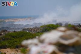 Smoke rises from piles of garbage dumped on Jazeera Beach, in Somalia's capital, Mogadishu. (Courtesy - Jamal Ali)