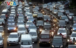 In this Sept. 24, 2010 photo, motorists are stuck in traffic jam during an evening rush hour at the main business district in Jakarta, Indonesia.
